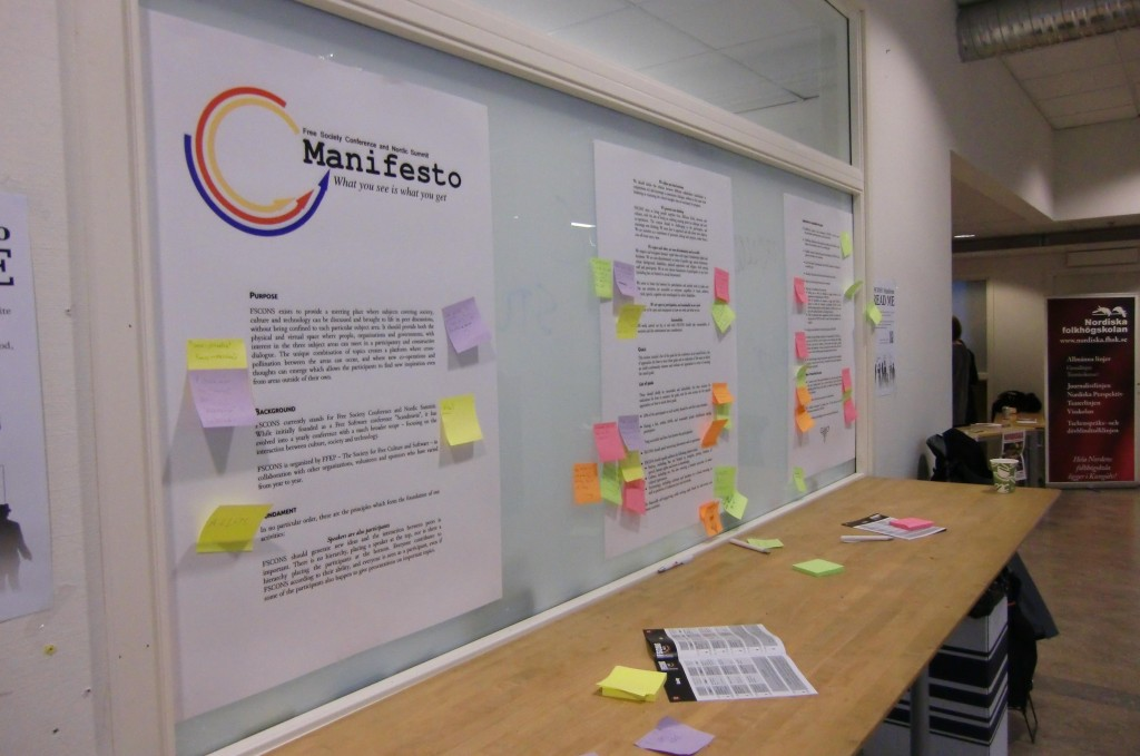 Print out of Manifesto plastered with sticky notes on whiteboard