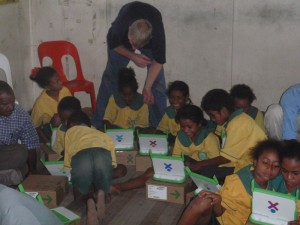 children fiddling with the OLPC for the first time
