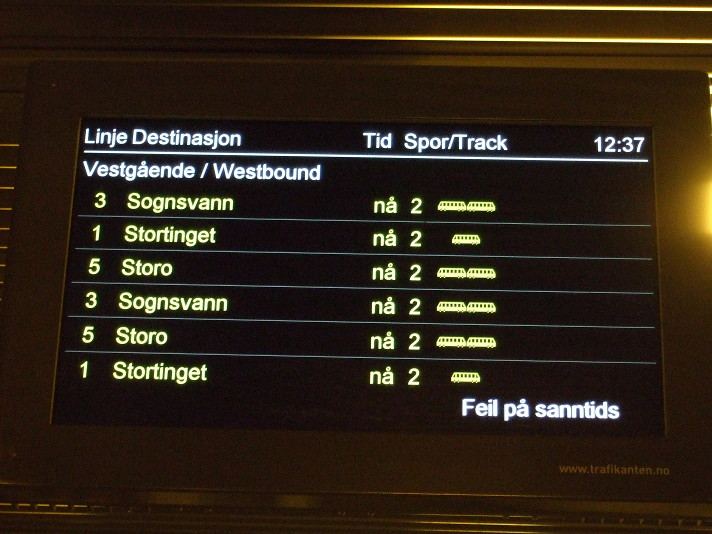 "Nothing wrong here: a public transport ""real time"" system failure; all the trains are arriving ""now"""