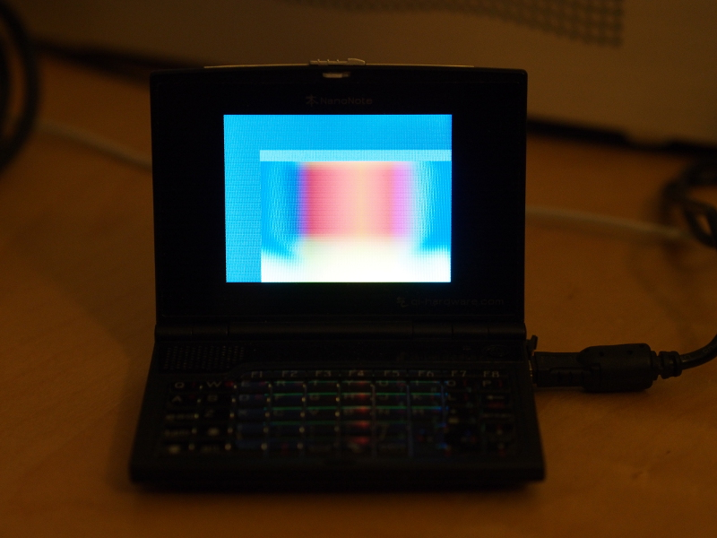 "The Ben NanoNote showing the ""spectrum"" framebuffer example"